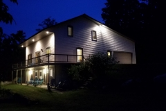 1399-S-Lake-Leelanau-Dr-Retreat-House-Evening-scaled